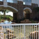 Bridge over calm waters at Sapphire Falls Resort